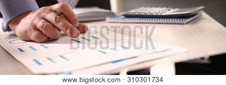 Accountant Calculate Tax Invoice Using Calculator. Man Writing Note About Asset Cost At Office. Payc