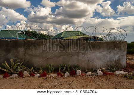 Wall And Barbed Wire Protecting The Safety Of Tourists In A Lodge In Samburu Park, Kenya