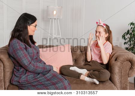 Teen Girl On Reception At The Psychotherapist. Psychotherapy Session For Children. The Psychologist