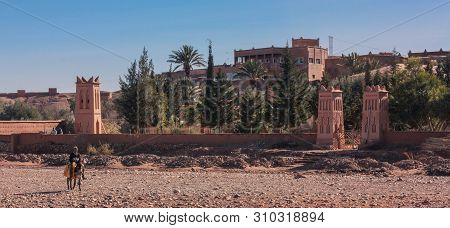 Ouarzazate, Morocco, Africa - January 15, 2014: View Of The Dry Riverbed With A Person On A Small Do