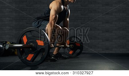 Handsome Weightlifter Preparing For Training. Training With Barbell, Athletic Shirtless Young Sports