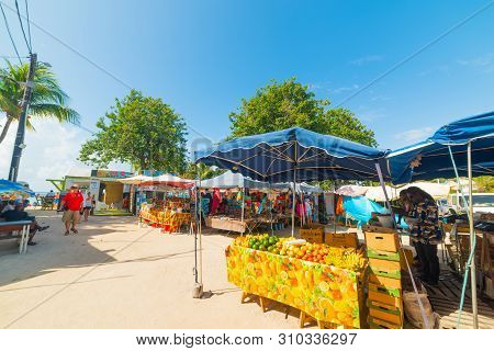 Guadeloupe, Fr - February 17, 2019: Fruits And Souvenirs Stands In Guadeloupe, French West Indies. L