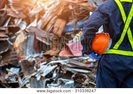 Waste Recycling Engineer Holding A Safety Helmet Suit Standing In The Outdoor Recycling Center Have