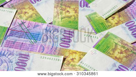 Collection of the Swiss 1000 franks banknotes. 1000 franks note issued by Swiss National Bank (SNB) is one of the most valueable banknotes in the world and are in circulation in Switzerland since 1995