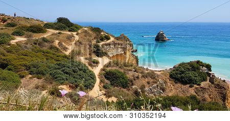 Beautiful Landscape: Hiking Paths On Rocky Cliffs Near The Beach Praia Dona Ana, Lagos, Portugal