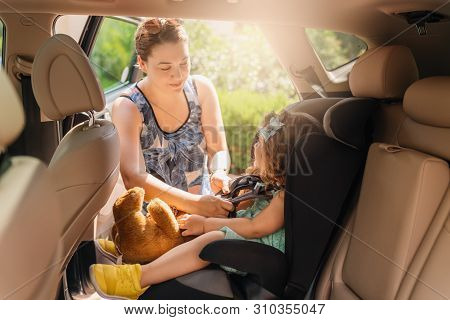 Cute Little Baby Child Sitting In Car Seat. Portrait Of Cute Little Baby Child Sitting In Car Seat.s