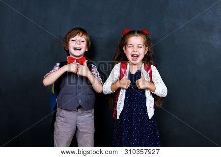 Intelligent Smart Happy Schoolboy And Schoolgirl Playing In Mathematic Teacher Opposite School Chalk