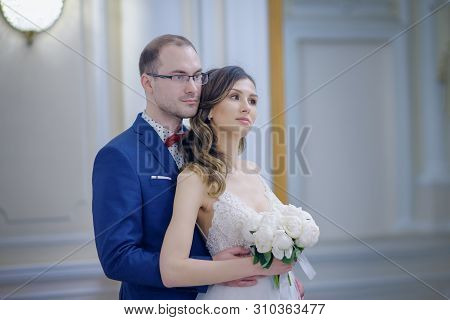 Wedding Photoshoot Of Just Married Couple. They Are Standing In Beautiful Wedding Palace And Enjoyin