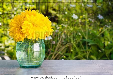 """Bouquet Of Flowers """"golden Ball"""" In A Vase On A Wooden Table"""