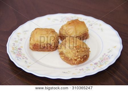Traditional Turkish Puff Sweetness Baklava With Nuts On A White Plate