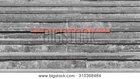 Red Steps On The Gray Concrete Staircase