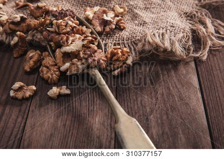 Walnuts On An Old Spoon And Composition From Old Wood And Material