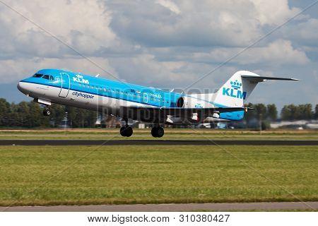 Klm Fokker 70 Ph-kzs Passenger Plane Departure At Amsterdam Schipol Airport