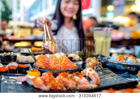Asian Lady Eat A Salmon Fish Sashimi And Sushi In Japanese Restaurant For Good Healthy, Tokyo, Japan