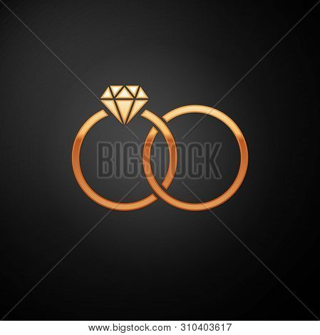 Gold Wedding Rings Icon Isolated On Black Background. Bride And Groom Jewelery Sign. Marriage Icon.