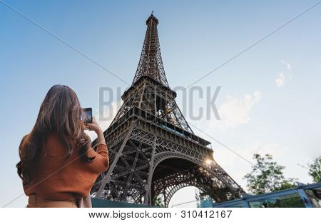 Travelling In Europe, Traveler Woman Taking Photo Of Eiffel Tower, Famous Landmark And Travel Destin