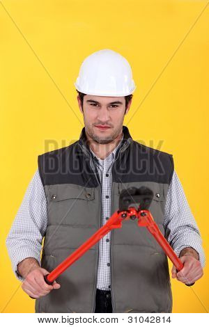 Construction worker with boltcutters