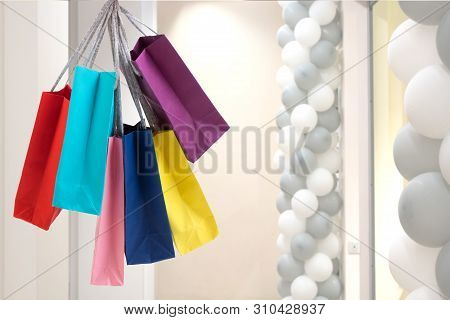 Many Colorful Shopping Bags On The Background Of The Shopping Center.
