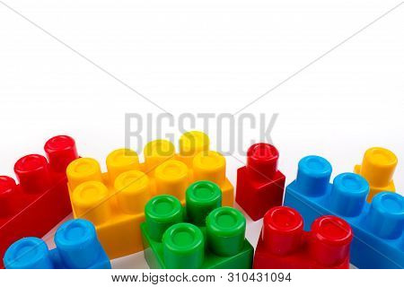 Lot Of Colorful Rainbow Toy Bricks Background. Educational Toy, Constructor For Children Isolated On