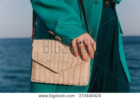 Attractive Busty Curvy Woman In A Style Outfit On The Beach. Trendy Accessories, Straw Bag, Fashion