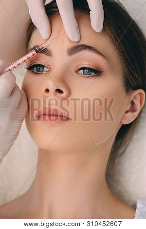 Woman Gets An Injection Blocking Mimic Wrinkles On The Forehead Area