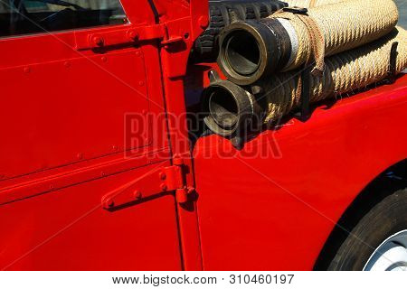 Detail Of Old Vintage Firetruck With Fire Hose