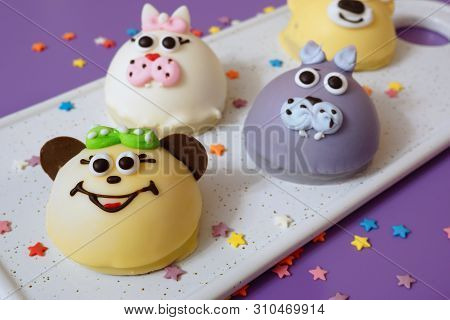 Cake In The Form Of Little Animals. Homebaked Soufflé In The Glaze Is Framed In The Shape Of Animal