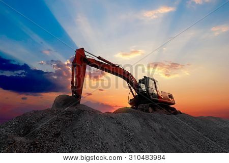 Silhouette Excavator Working On Construction Site. Construction Equipment Of Street Construction. Bu