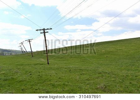 Agnita, Romania; Telephone Line Poles Defying Gravity