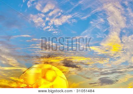 Beautiful Multicolored Sunrise With Golden Football Ball.