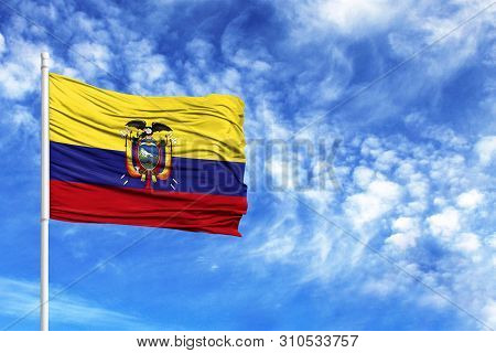 National Flag Of Ecuador On A Flagpole In Front Of Blue Sky