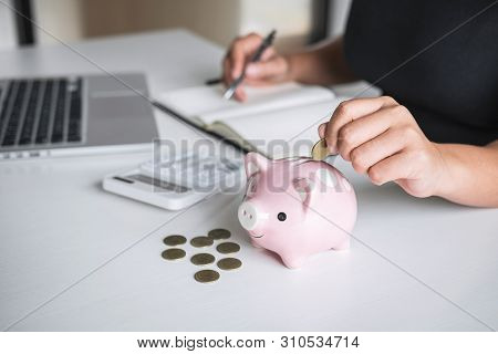 Woman Putting Golden Coin In Pink Piggy Bank For Step Up Growing Business To Profit And Saving With