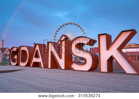Gdansk city outdoor sign with rainbow at Olowianka island, Poland