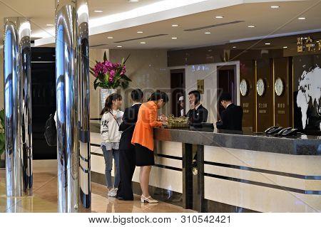 Pyongyang, North Korea - May 1, 2019: People In Reception Of The Modern Yanggakdo Hotel. The Yanggak