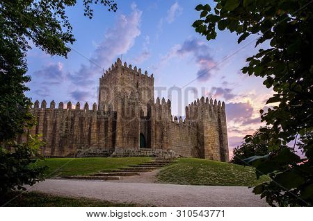 Guimaraes, Portugal - July 7, 2019 : Colorful Sunset Castle Guimaraes, Portugal