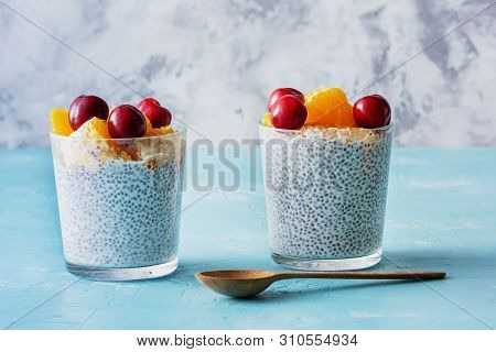 Healthy Yogurt With Chia Seeds And Cherry In Glass. Dietary Smoothie Blended With Fruit And Decorate