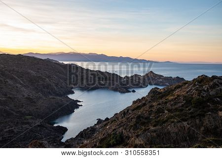 View of the coastline with sunset sky colors in Cap de Creus, Catalunya poster