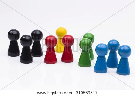 The Photo Shows Different Coloured Wooden Figures Isolated On White