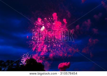 Inexpensive Fireworks Over The City Red, Pink And White. Bright And Shiny.  For Any Purpose. Celebra