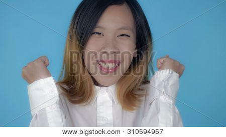Close Up Portrait Young Asian Woman Laughing Celebrating Success Or Good News Or Win Her Team On Blu