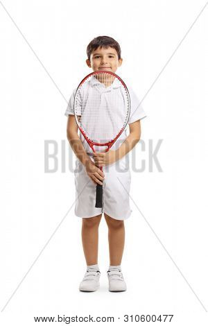 Full length portrait of a boy tennis player holding a racquet and looking at the camera isolated on white background