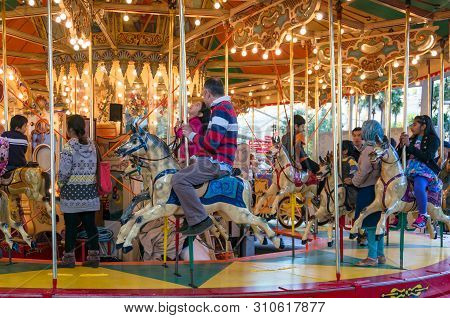 Sydney, Australia - August 04, 2013: Merry-go-round Carousel With Children And Adults Having Fun In