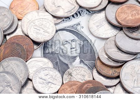 Money, Us Dollars Bank Notes, Penny, Nickel, Dime, Quarter On A White Background.