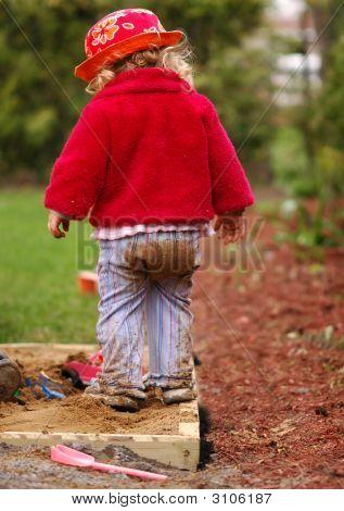 Girl Playing In The Sandbox