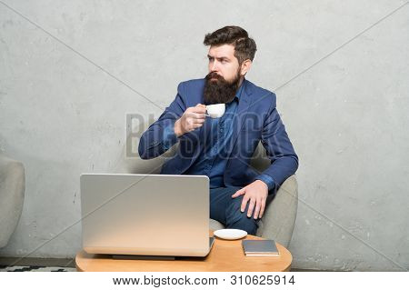 Im Freelancing Now. Freelance Worker. Freelancer Enjoying Coffee And Free Wifi. Bearded Man Working