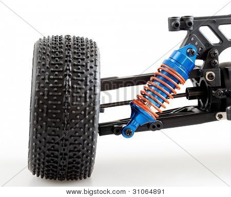 suspension of modern radio controlled car for competitions on white background