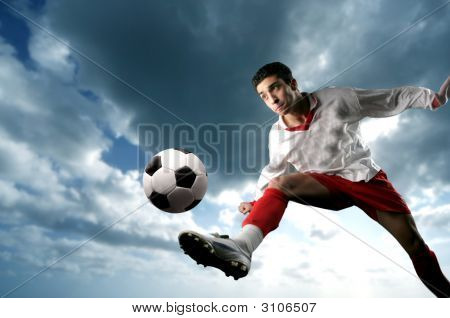 a soccer player in action and a sunset