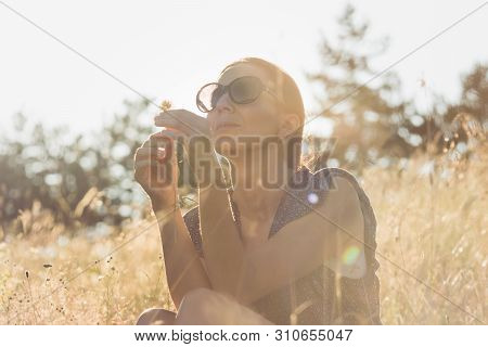 Woman In Nature In Sunset. People In Nature. Beautiful Woman In Meadow Sunset. Beautiful People. Hap