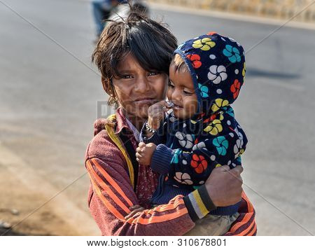 Ajmer, India - February 07, 2019: Indian Boy With Child On The Street. Poor People Come With Family