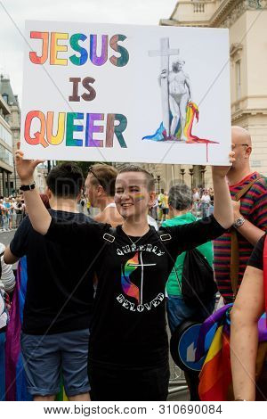London, United Kingdom, 6th July 2019:- Participant In London Pride 2019 Holding A Sign Reading Jesu